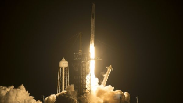 Astronauts aboard SpaceX capsule prepare for docking at ISS