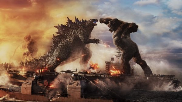 Godzilla battles Kong on an aircraft carrier