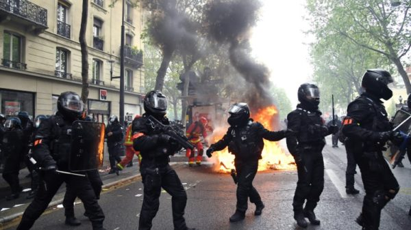 Scuffles, arrests in Paris as thousands mark May Day