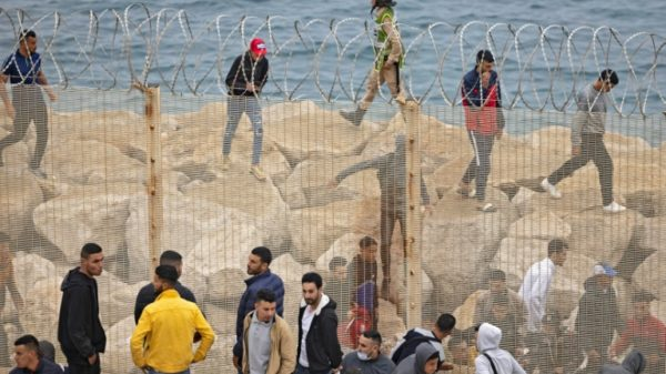 Europe or 'death' for Moroccans scrambling into Spanish enclave