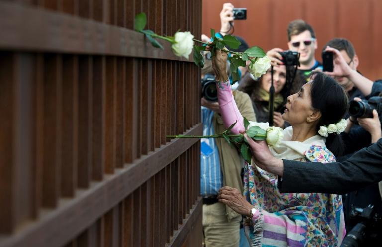 Myanmar protesters wear flowers to mark Suu Kyi's birthday