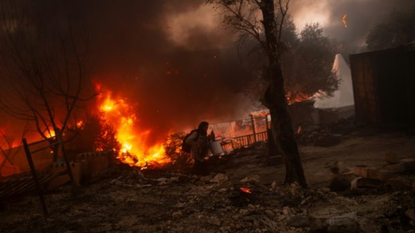 Four Afghans get 10-year jail terms for Greek migrant camp fire