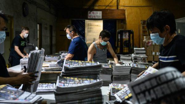 Crackdown brings resignations at embattled Hong Kong pro-democracy paper