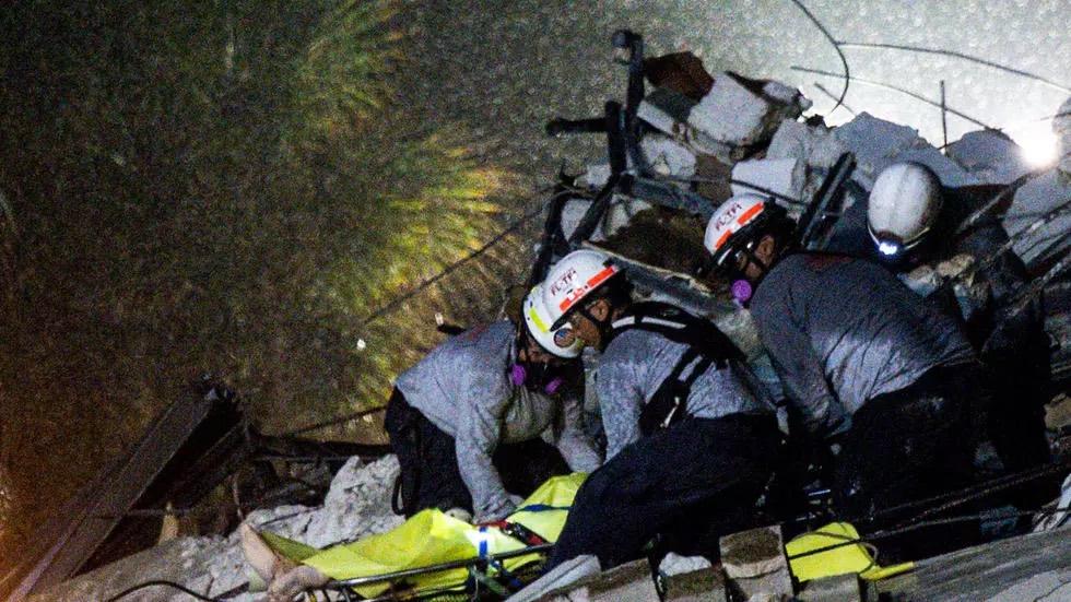 Crews comb rubble of collapsed Florida condo, 99 unaccounted for