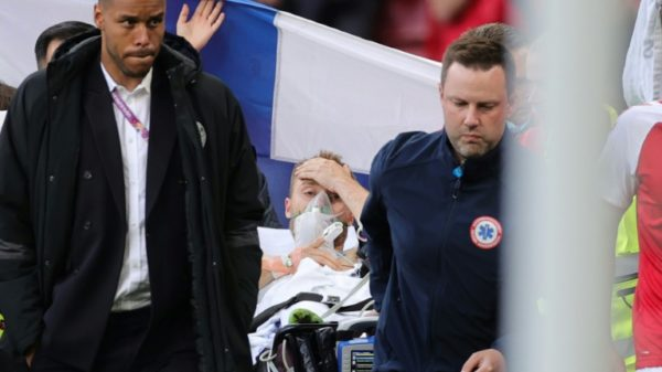 Denmark's Eriksen 'awake' in hospital after collapsing at Euro 2020