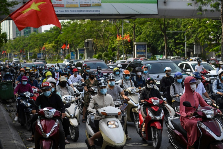 Vietnam begs public for 'vaccine fund' donations after virus surge
