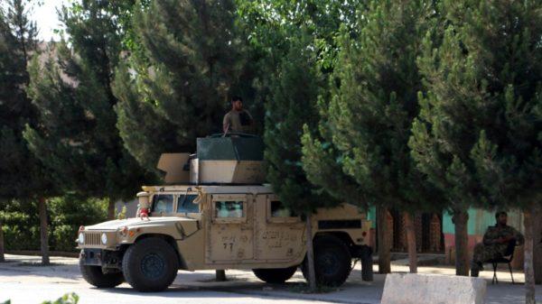 Fear stalks northern Afghan city as Taliban lay siege