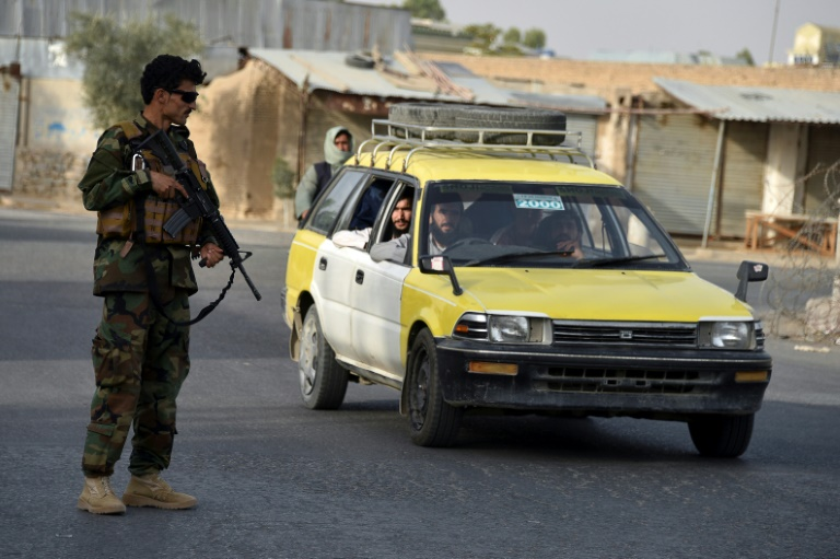 Thousands of Afghan families flee fighting in former Taliban bastion