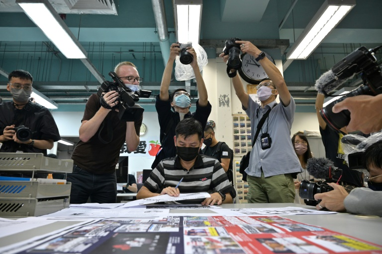 Hong Kong police arrest another Apple Daily editor under security law