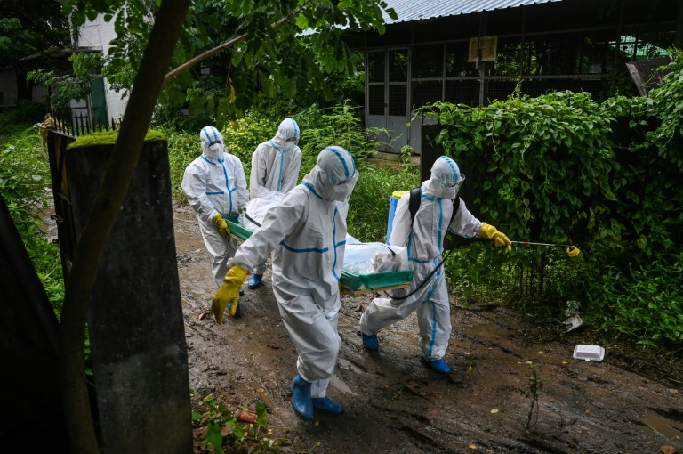 Delivering the dead and helping the living in Myanmar virus spike