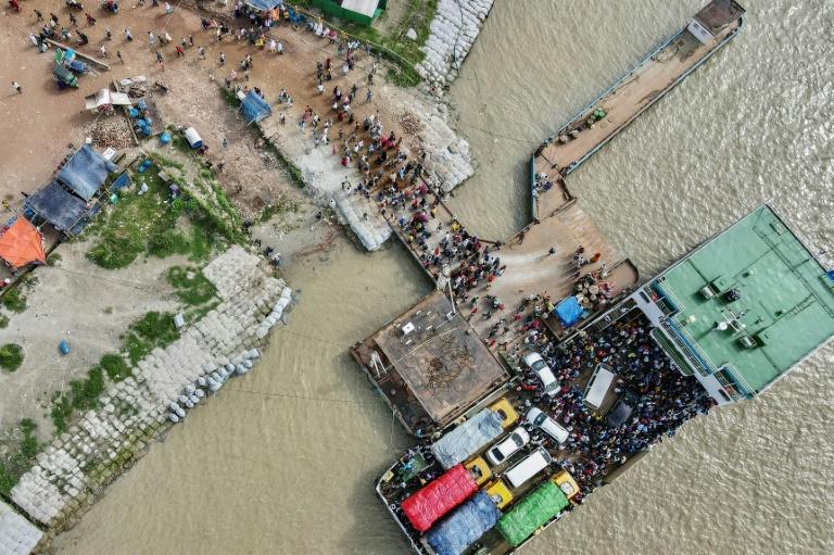 Bangladeshis rush back to work as factories reopen despite virus surge