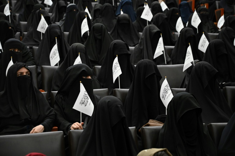 Veiled protest: Afghan women rally in support of the Taliban