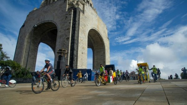 Afghan refugees cycle in traditional Mexico City bike ride