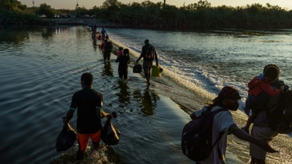US to step up 'removal flights' for migrants stranded at Texas bridge