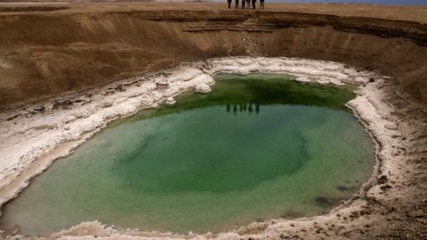 Sinkholes on receding Dead Sea shore mark 'nature's revenge'