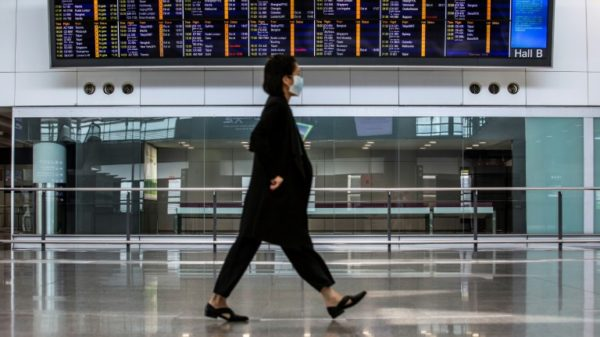 Hong Kong to further tighten Covid travel restrictions