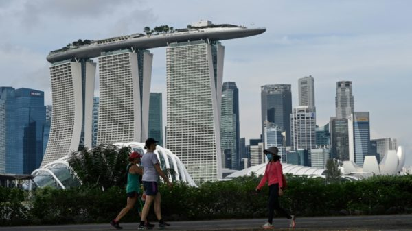 Singapore says healthcare system risks being 'overwhelmed' as virus surges