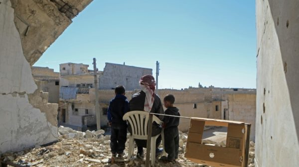 In Syria frontline town, residents 'stuck' between rivals