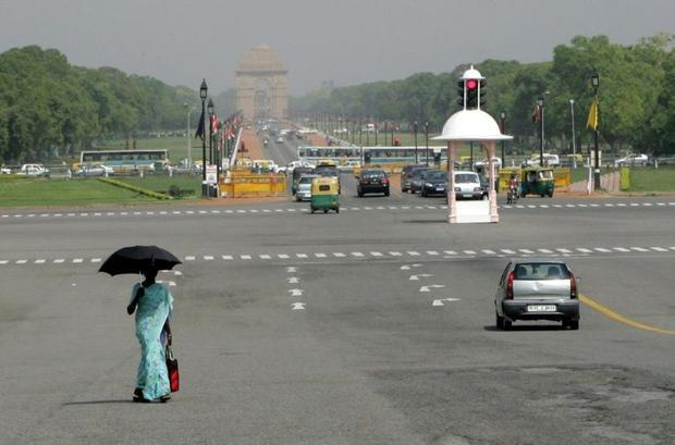 A woman in New Delhi carries an umbrella to protect herself from the blazing sun  one way of avoidin...