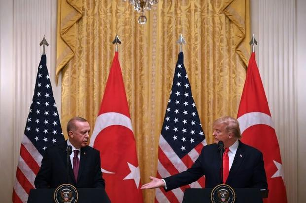 US President Donald Trump and Turkey's President Recep Tayyip Erdogan hold a joint news confere...