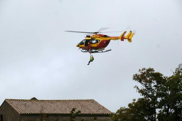 Authorities rushed in helicopters to help with rescue operations  particularly those in the floodpla...