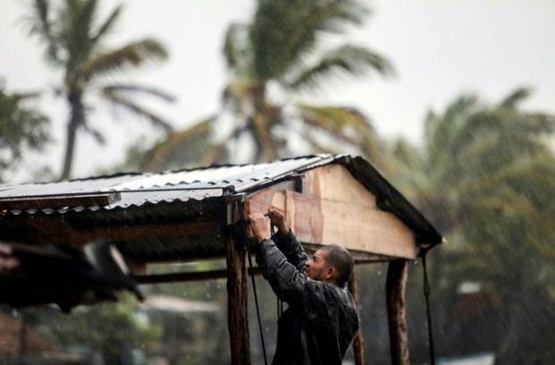 A man struggles to protect his house as Hurricane Eta bore down on Nicaragua's northern Caribbe...