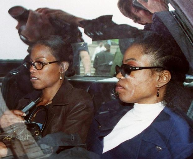 Prominent Black activist Malcolm X's daughters  including Qubilah Shabazz (R  pictured 1997) an...
