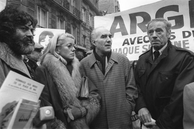 Michel Piccoli (second from right) demonstrates with  author Marek Halter (left)  French actress Cat...