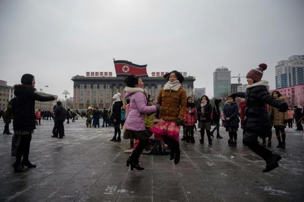 Children play games on Kim Il Sung square during celebrations marking the Lunar New Year on Mansu Hi...