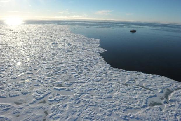 Canadian Coast Guard Ship (CCGS) Amundsen  a research icebreaker  navigates near an ice floe along D...