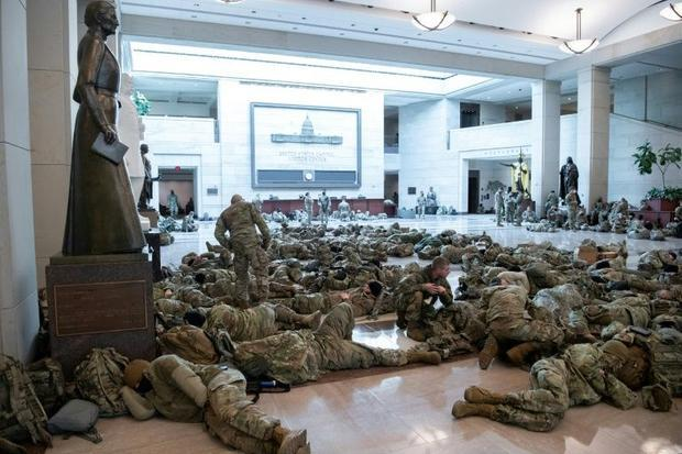 Members of the National Guard catch a rest inside the Capitol building
