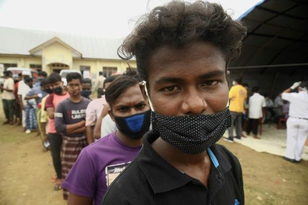 When hundreds of Rohingya refugees paid traffickers to escape their squalid camp in Bangladesh  they...