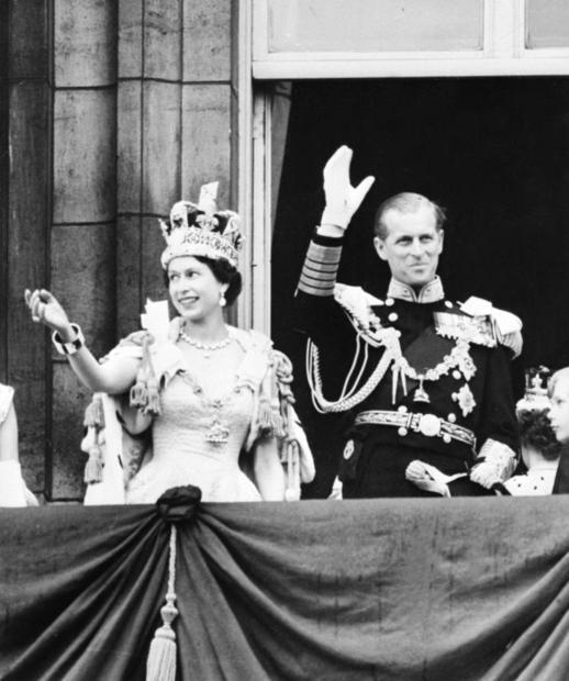 Queen Elizabeth II  accompanied by Prince Philip  waves to the crowd following her coronation at Wes...