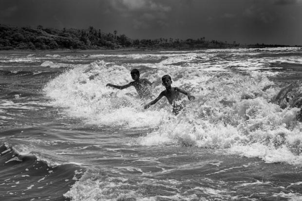Boys playing in surf. Mumbai  India.