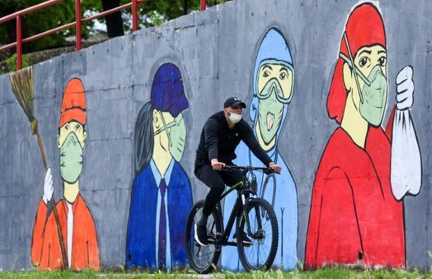 A mural in Skopje inspired by the coronavirus illustrates the measures voters will have to go to whe...