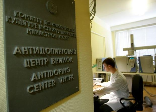A technician sits at the Moscow anti-doping laboratory  were work has been suspended over accusation...
