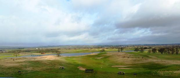 A view of the edge of the golf course and the splendid countryside  as seen from within the hotel.