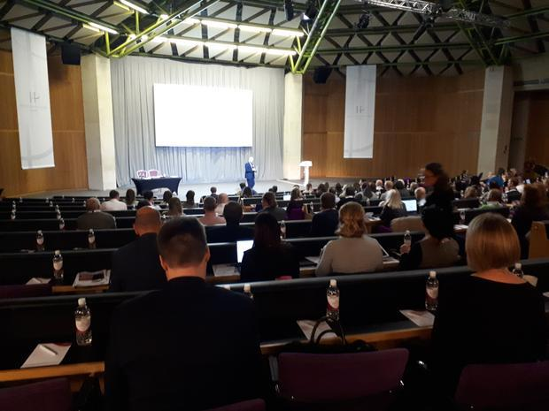 Scene from the November 2017 Pharmig conference  with the chair David Keen introducing the rapid mic...