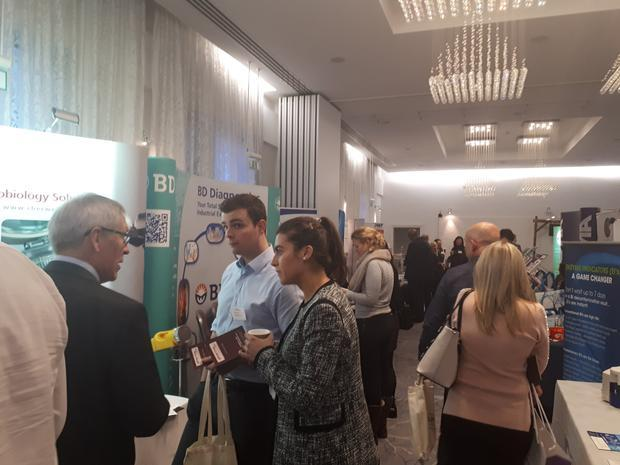 Exhibitors examining microbiological methods at the Pharmig conference.