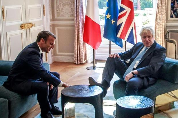 Johnson met Macron at the Elysee palace where he was pictured putting his foot on a table