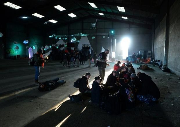 People wait after an illegal New Year party in Rennes  France  that the police tried to break up