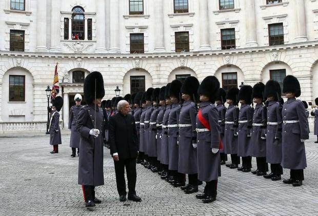 Indian Prime Minister Narendra Modi inspects a guard of honour outside the Treasury in London on Nov...