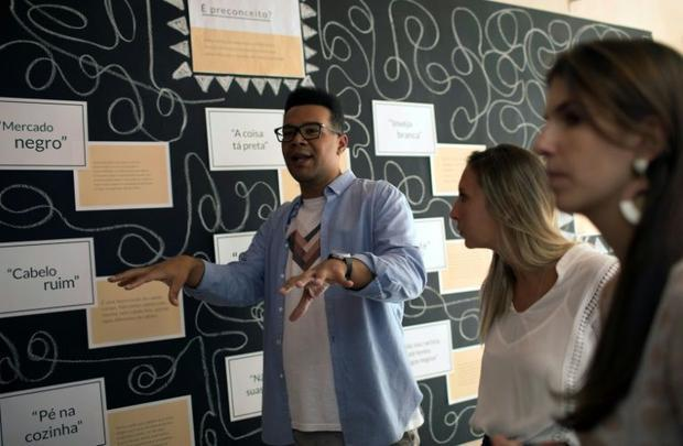 Esteban Cipriano  in charge of education programs at the anti-racism group ID_BR  talks to employees...