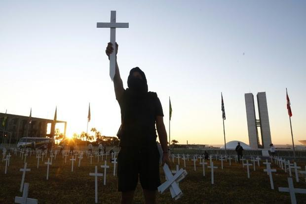 One of thousands of protesters demonstrating across Brazil against the pandemic response of Presiden...