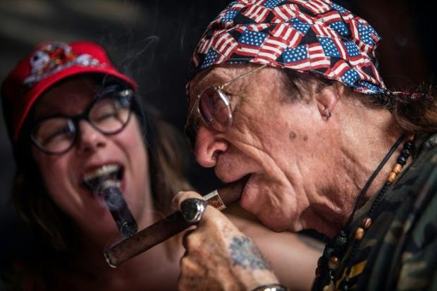 Tourists draw on local cigars during a festival in Esteli