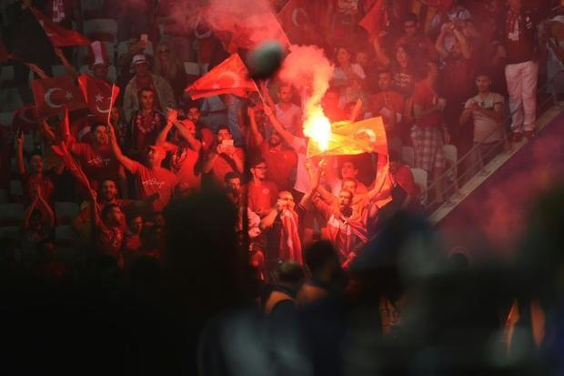 Turkey could face the wrath of European football's governing body after fans lit flares and thr...
