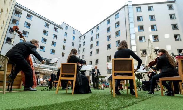 Guests at the Hotel Zeitgeist listened from their rooms to the singers and orchestra