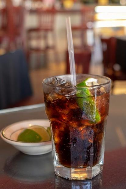 Cuba Libre  a classic Cuban cocktail made with run and Coca Cola plus some drops of lime juice  phot...