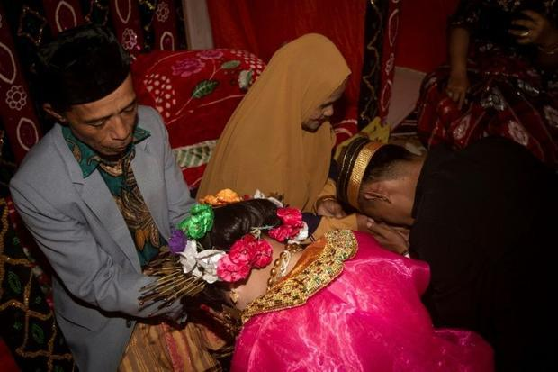 Child marriage has long been common in traditional communities from the Indonesian archipelago to In...