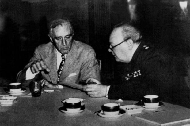 US president Franklin Roosevelt  (L) and British prime minister Winston Churchill (R) meeting during...